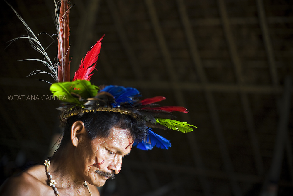A Bar&aacute; Indigenous man living at S&atilde;o Gabriel da Cachoeira, uses the Baniwa Maloca (House of Knowledge) to express his own traditions and share with the community. With a peculiar humor, he was listed as 'dangerous indigenous man' by the Baniwa's leader because he exhibits a mustache (not usual for the indigenous in the area).<br />