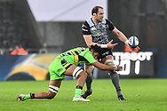 Ospreys' Alun Wyn Jones is tackled by Northampton Saints' Lewis Ludlam<br /> <br /> Photographer Craig Thomas/Replay Images<br /> <br /> EPCR Champions Cup Round 4 - Ospreys v Northampton Saints - Sunday 17th December 2017 - Parc y Scarlets - Llanelli<br /> <br /> World Copyright © 2017 Replay Images. All rights reserved. info@replayimages.co.uk - www.replayimages.co.uk