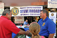 Bellmore, New York, USA. 20th September 2015. Nassau County Legislator STEVE RHOADS (Republican - 19th District - Bellmore) running for re-election, meets people at the 29th Annual Bellmore Family Street Festival, featuring family fun with exhibits and attractions.