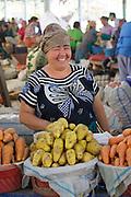 Uzbekistan, Tashkent. Chorsu Bazaar.<br /> Woman with carrots.
