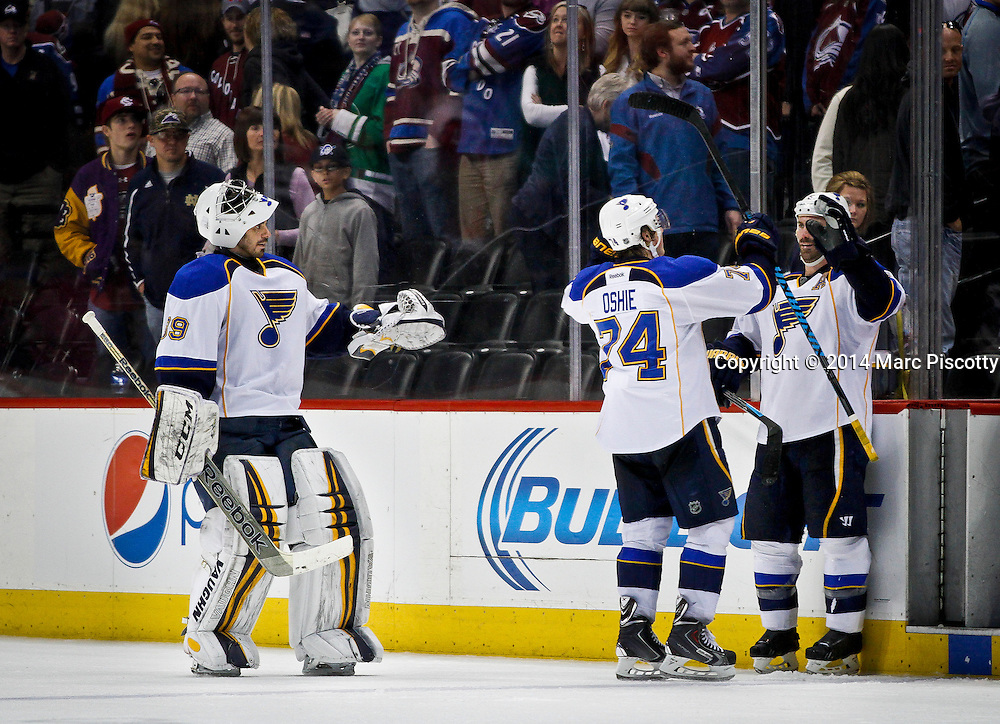 SHOT 3/8/14 4:35:30 PM - The St. Louis Blues' Barret Jackman #5 congratulates teammates T.J. Oshie #74 and goaltender Ryan Miller #39 after a win over the Colorado Avalanche during their regular season Western Conference game at the Pepsi Center in Denver, Co. The Blues won the game 2-1.<br /> (Photo by Marc Piscotty / &copy; 2014)