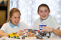 Eleven year olds Anabel Sweeney and Emma Beashel from St Gerards' Junior School in Bray getting the teams robot ready for the  FIRST LEGO League 2012 competition sponsored by SAP in the Radisson blu hotel in Galway. Photo:Andrew Downes.