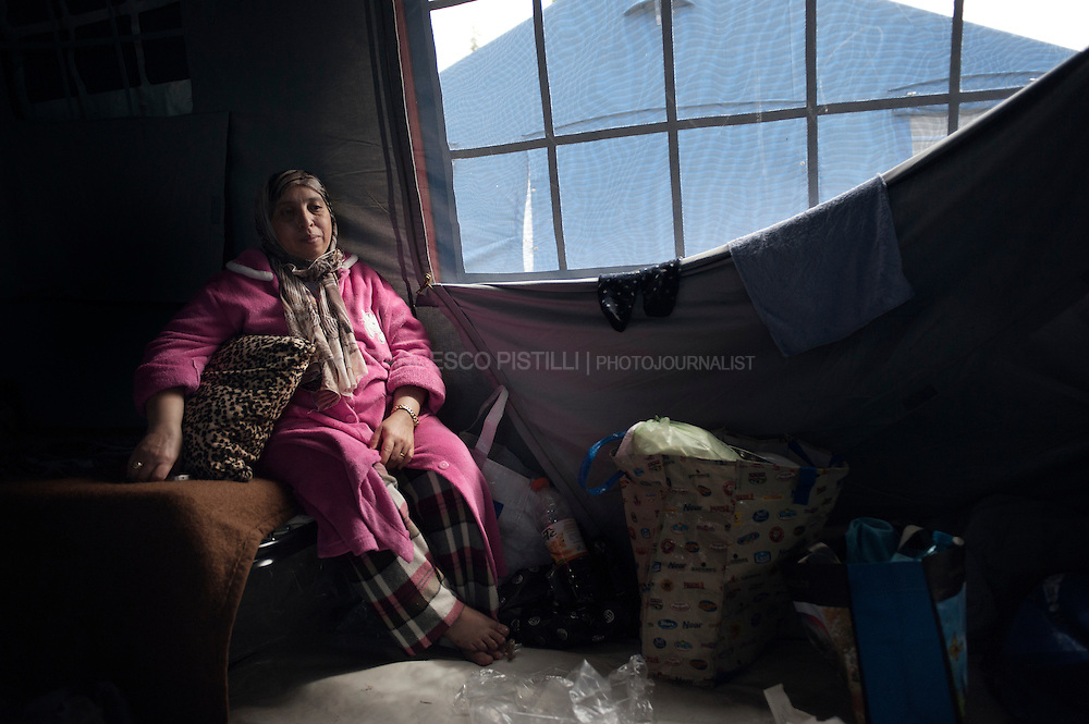 Italy. May 2012. Finale Emilia (MO). A displaced woman inside the camp. <br />