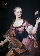 Portrait of Anna Maria Baroness Erberg (c1741-1769). Oil on canvas.  Forunat Bergant (1721-1769) Slovene painter.  Three-quarters portrait of  fashionable woman in silks holding a fully blown pink rose. Jewelry Pearl