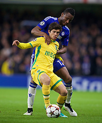 LONDON, ENGLAND - Wednesday, December 10, 2014: Chelsea's John Mikel Obi in action against Sporting Clube de Portugal's Andre Geraldes during the final UEFA Champions League Group G match at Stamford Bridge. (Pic by David Rawcliffe/Propaganda)