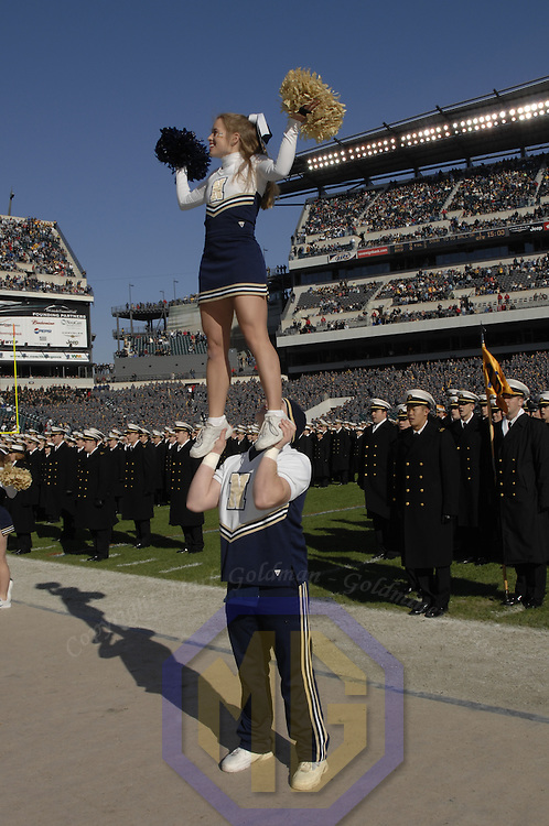 02 December 2006:  Navy cheerleaders perform prior to the start of the game against Army on December 2, 2006.  The Navy Midshipmen defeated the Black Knights of Army 26-14 at Lincoln Financial Field in Philadelphia, Pennsylvania.