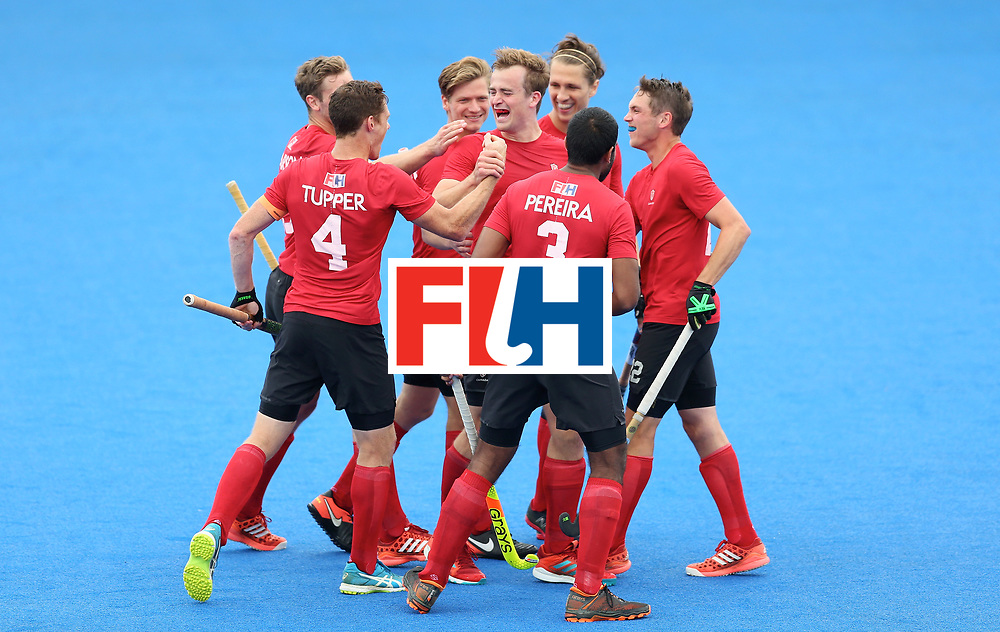 LONDON, ENGLAND - JUNE 25:  Gordan Johnston of Canada celebrates scoring their teams third goal with teammates during the 5th/6th place match between India and Canada on day nine of the Hero Hockey World League Semi-Final at Lee Valley Hockey and Tennis Centre on June 25, 2017 in London, England.  (Photo by Steve Bardens/Getty Images)