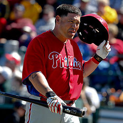 Mar 4, 2013; Bradenton, FL, USA; Philadelphia Phillies catcher Humberto Quintero (12) reacts after striking out against the Pittsburgh Pirates during the top of the third inning of a spring training game at McKechnie Field. Mandatory Credit: Derick E. Hingle-USA TODAY Sports