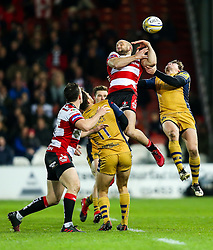 Charlie Sharples of Gloucester Rugby and Rhodri Williams of Bristol Rugby compete in the air for a high ball - Rogan Thomson/JMP - 03/12/2016 - RUGBY UNION - Kingsholm Stadium - Gloucester, England - Gloucester Rugby v Bristol Rugby - Aviva Premiership.