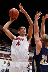 November 10, 2010; Stanford, CA, USA;  Stanford Cardinal forward Stefan Nastic (4) shoots over Cal State Monterey Bay Otters forward Ian Hosford (22) during the second half at Maples Pavilion.  The Cardinal defeated the Otters 87-56.
