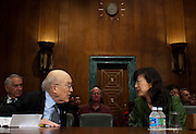 "Former Senator ALAN SIMPSON, (R-WY) and MONICA YOUN, senior counsel in the Democracy Program at the Brennan Center for Justice at NYU School of Law confer before a Senate Judiciary Subcommittee hearing on Campaign Finance Reform and ""The Fair Elections Now Act: A Comprehensive Response to Citizens United."","