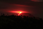MINAHASA, INDONESIA - MARCH 08: <br /> <br /> Eruption Of Mount Soputan Volcano In Indonesia<br /> <br /> A view of the Mount Soputan volcano eruption seen from Amurang village on March 08, 2015 in Minahasa, North Sulawesi, Indonesia. <br /> <br /> The eruption began on March 08, 2015 spewing ash and other pyroclastic material to heights of 4500 meters.<br /> ©Ronny Adolof Buol/Exclusivepix Media
