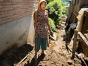 03 AUGUST 2015 - SANKHU, NEPAL:  A woman digs up mud to be used as mortar in the repair of a home destroyed in the earthquake in Sankhu, a community about 90 minutes from central Kathmandu. The Nepal Earthquake on April 25, 2015, (also known as the Gorkha earthquake) killed more than 9,000 people and injured more than 23,000. It had a magnitude of 7.8. The epicenter was east of the district of Lamjung, and its hypocenter was at a depth of approximately 15 km (9.3 mi). It was the worst natural disaster to strike Nepal since the 1934 Nepal–Bihar earthquake. The earthquake triggered an avalanche on Mount Everest, killing at least 19. The earthquake also set off an avalanche in the Langtang valley, where 250 people were reported missing. Hundreds of thousands of people were made homeless with entire villages flattened across many districts of the country. Centuries-old buildings were destroyed at UNESCO World Heritage sites in the Kathmandu Valley, including some at the Kathmandu Durbar Square, the Patan Durbar Squar, the Bhaktapur Durbar Square, the Changu Narayan Temple and the Swayambhunath Stupa. Geophysicists and other experts had warned for decades that Nepal was vulnerable to a deadly earthquake, particularly because of its geology, urbanization, and architecture.    PHOTO BY JACK KURTZ