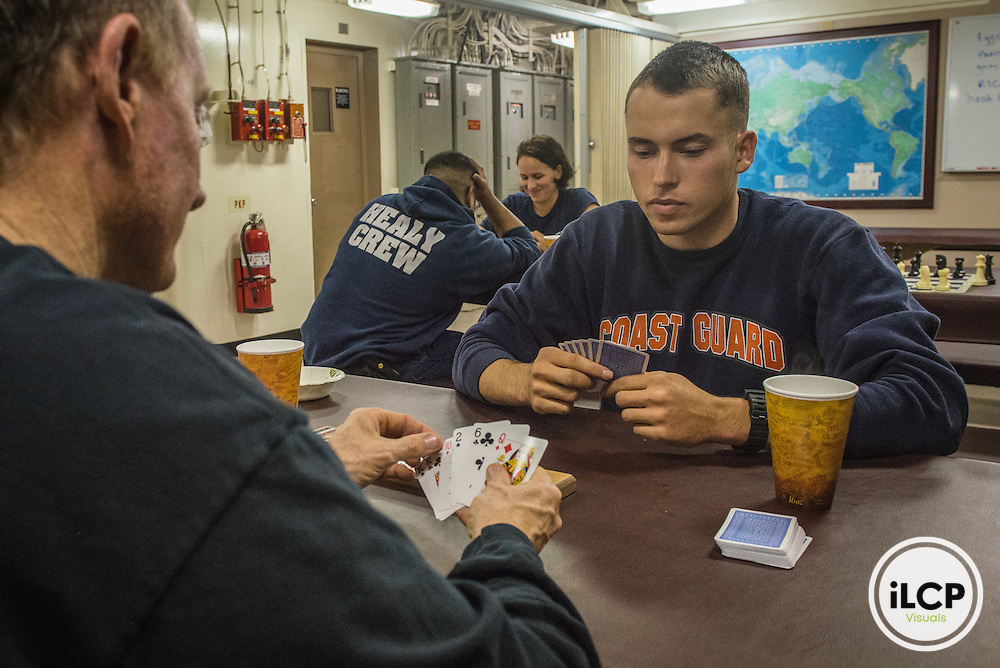 In breaks between duties playing card in US Coast Guard Ship Healy eatery. Arctic Ocean, USA, 07.16.2015, Esther Horvath / iLCP