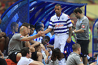 Football - Anton Ferdinand of QPR greets his teammates after being subsitute during the friendly match against Kelantan Select XI during the QPR Asian Tour 2012 at the Shah Alam Stadium, Selangor, Malaysia