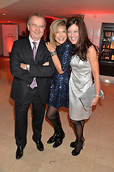 Left to right, IAN HISLOP, PENNY SMITH and VICTORIA HISLOP at the Costa Book Awards 2013 held at Quaglino's, 16 Bury Street, London on 28th January 2014.