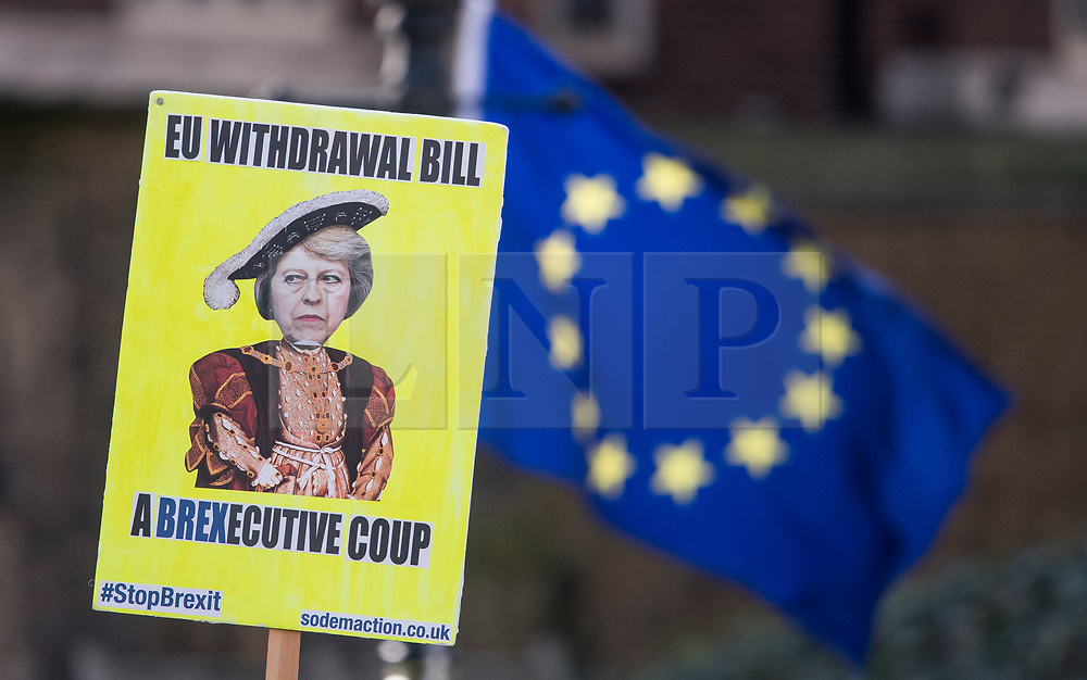 © Licensed to London News Pictures. 31/01/2018. London, UK. A protest banner depicting Theresa May alongside the Union Flag outside the House of Parliament in London in protest at Brexit and the UK's decision to leave the EU.Photo credit: Ben Cawthra/LNP