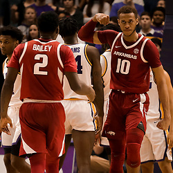 Feb 2, 2019; Baton Rouge, LA, USA; Arkansas Razorbacks forward Daniel Gafford (10) reacts after scoring with forward Adrio Bailey (2) during the second half against the LSU Tigers at the Maravich Assembly Center. Mandatory Credit: Derick E. Hingle-USA TODAY Sports