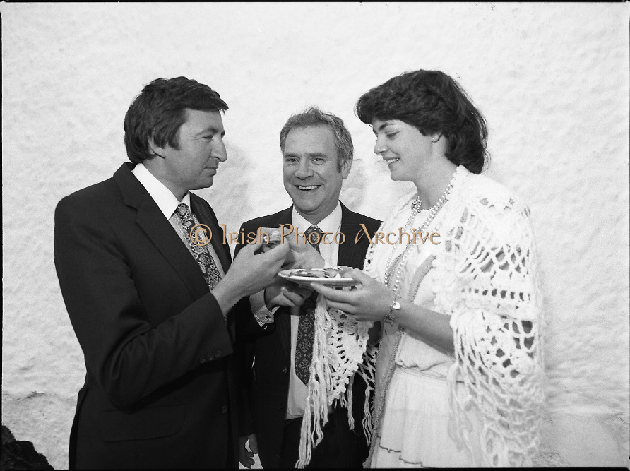 "The Carlingford Oyster Festival.1982.19.08.1982..08.19.1982.19th August 1982..Pictures and Images of the Carlingford Oyster Festival... The Minister For Fisheries and Forestry Mr Brendan Daly officially opened  The Carlingford Oyster Festival. The Chairman of the organising committee was Mr. Joe McKevitt..""The Oyster Pearl"" was Ms Deirdre McGrath..The Minister is encouraged to try an oyster himself..."