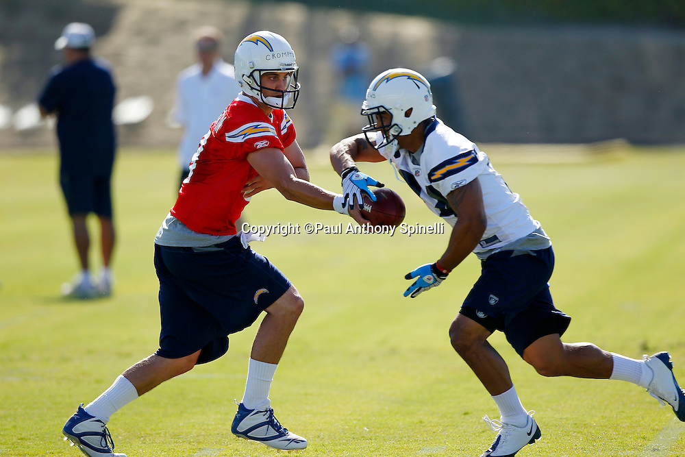 San Diego Chargers rookie quarterback Jonathan Crompton (8) hands off the ball to rookie running back Ryan Mathews (24) during a Chargers rookie minicamp on May 7, 2010 in San Diego, California. (©Paul Anthony Spinelli)