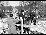 Hunt meets at Brittas, Co Dublin.    (K85)..1977..29.01.1977..01.29.1977..29th January 1977..A new year hunt meet was held today at Brittas,Co Dublin.The hunt started at Brittas Lodge..Image shows a helpful assistant supplying the hot toddies to the riders before they start the hunt.