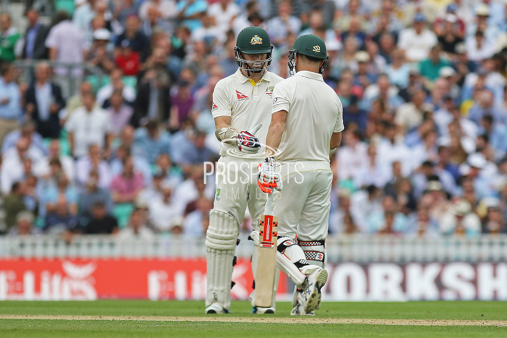 David Warner of Australia is congratulated for his 50 by Chris Rogers of Australia during the 1st day of the 5th Investec Ashes Test match between England and Australia at The Oval, London, United Kingdom on 20 August 2015. Photo by Phil Duncan.