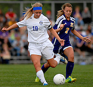 11 MAY 2012 -- ALTON, Ill. -- Alton Marquette High School soccer player Cassie McFadden (19) battles Civic Memorial High School's Mackenzie Perkins (7) for control of the ball during the Class 1A Regional Finals at Gordon Moore Park in Alton Friday, May 11, 2012. Photo © copyright 2012 Sid Hastings.