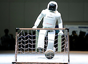 Honda's humanoid robot Asimo kicks a soccer ball during a demonstartion at Robo Japan 2008 in Yokohama, Japan.