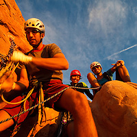 Climbers prepare to descend from The Owl Spire in Arches National Park, Utah