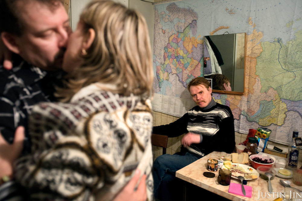 Valery Zhukov, a married miner and union representative in Severny village outside Vorkuta, dances with his lover Lena who lives in the same neighborhood. His friend Alexander is in the back and says he wants the same woman..Vorkuta is a coal mining and former Gulag town 1,200 miles north east of Moscow, beyond the Arctic Circle, where temperatures in winter drop to -50C. .Here, whole villages are being slowly deserted and reclaimed by snow, while the financial crisis is squeezing coal mining companies that already struggle to find workers..Moscow says its Far North is a strategic region, targeting huge investment to exploit its oil and gas resources. But there is a paradox: the Far North is actually dying. Every year thousands of people from towns and cities in the Russian Arctic are fleeing south. The system of subsidies that propped up Siberia and the Arctic in the Soviet times has crumbled. Now there's no advantage to living in the Far North - salaries are no higher than in central Russia and prices for goods are higher.