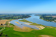 Nederland, Gelderland, Gemeente Brakel, 23-08-2016; Buitenpolder Het Munnikeland, ten oosten van Loevestein aan rivier de Waal. In het kader van het programma Ruimte voor de Rivier is de Waaldijk landinwaarts verlegd en heeft de Waal meer ruimte gekregen waardoor de rivier bij extreem hoogwater meer water kan afvoeren. Ook zijn er geulen gegraven in de uiterwaarden die voor een nog betere afvoer zorgen. <br /> National Project Ruimte voor de Rivier (Room for the River): the Waaldike has been shifted (inland direction) and as a consequence the river can transport the water more efficient in cas of high waters. Also, trenches are dug in the floodplains that provide better drainage.<br /> <br /> luchtfoto (toeslag op standard tarieven);<br /> aerial photo (additional fee required);<br /> copyright foto/photo Siebe Swart