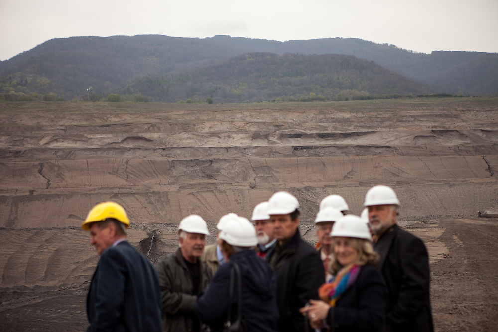 """A group of visitors at the North Bohemian Brown Coal Basin during a so called """"Czech Coal Safari"""" in Most area. The Czech Coal Group offers visitors the possibilty to see unique technical works in the mining areas of their surface mines."""