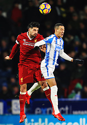 Emre Can of Liverpool challenges for a header with Tom Ince of Huddersfield Town - Mandatory by-line: Matt McNulty/JMP - 30/01/2018 - FOOTBALL - John Smith's Stadium - Huddersfield, England - Huddersfield Town v Liverpool - Premier League