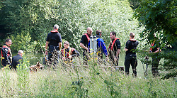 © licensed to London News Pictures. 15/07/2011. Maidenhead, UK. Police divers from a search and rescue team searching Cookham Lock near Maidenhead, Berkshire today (15/07/2011) where a man in his 50's went into the river trying to save his teenage daughter. Photo credit should read Ben Cawthra/LNP