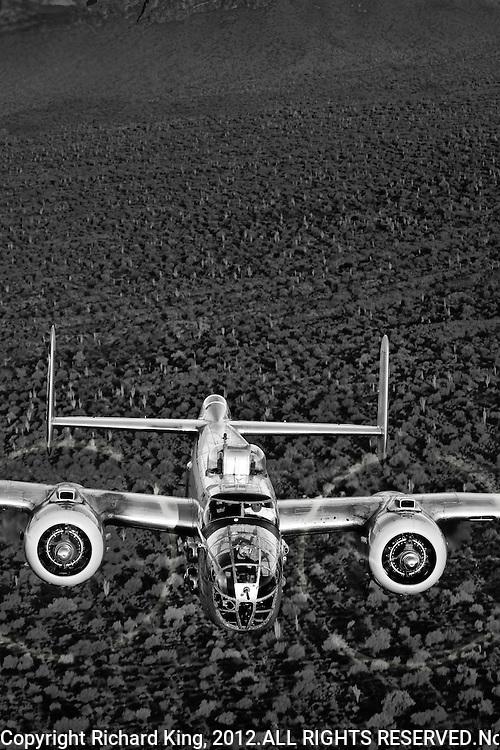 Black and White Photographic Print of B-25 Mitchell Bomber flying over the Arizona desert