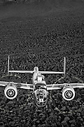 Black and White Photographic Print of B-25 Mitchell Bomber flying over the Arizona desert