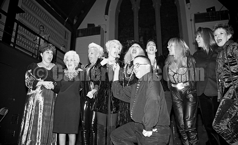 "December 5, 1990:  Michael Musto's birthday party at the Limelight nightclub in New York City.  L-R:  Sukreet Gabel, the star of the Lifetouch commercial (""I've fallen and I can't get up!""), High Voltage, Joey Heatherton, Sylvia Miles, Toni Senecal, Robin Byrd, Roxanne Pulitzer and Judy Carne.  Publicist Chip Duckett in front and Michael Alig on balcony in rear."