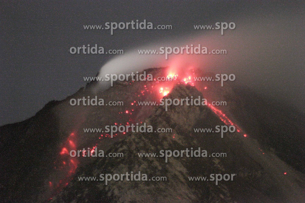 Photo taken on June 13, 2015 shows molten lava spilling out from the crater of Mount Sinabung in North Sumatra, Indonesia. More than 2,700 people moved from their homes near a volcano on Indonesia's Sumatra island on June 4 following a sharp increase in volcanic activity, an official said. EXPA Pictures &copy; 2015, PhotoCredit: EXPA/ Photoshot/ Ivan Damanik<br /> <br /> *****ATTENTION - for AUT, SLO, CRO, SRB, BIH, MAZ only*****