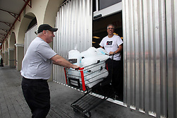 28 August 2012. New Orleans, Louisiana,  USA. <br /> Managers at the Winn Dixie in Uptown New Orleans collect ice and close down the store ahead of Hurricane Isaac. The 7th year anniversary of Hurricane Katrina is tomorrow and with a storm lurking in the Gulf many have evacuated as an uneasy calm settles over New Orleans.<br /> Photo; Charlie Varley