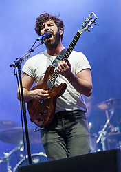 © Licensed to London News Pictures. 29/08/2015. Reading Festival, UK.  Foals performing a surprise set at Reading Festival 2015, Day 2.  In this picture - Yannis Philippakis.   Photo credit: Richard Isaac/LNP