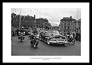 Cavalcade of President John F. Kennedy makes its way through Dublin, cheered on by thousands of spectators.<br />