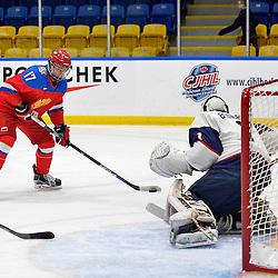 WHITBY, - Dec 17, 2015 -  Game #10 - United States vs. Russia at the 2015 World Junior A Challenge at the Iroquois Park Recreation Complex, ON. German Rubtsov #17 of Team Russia shoots the puck during the first period.<br /> (Photo: Shawn Muir / OJHL Images)
