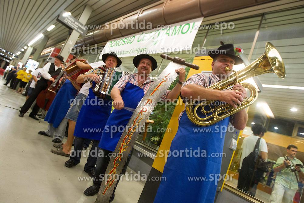 Music band Veseli Pruhovcani during reception Urska Zolnir and other athletes of Slovenian Olympic team, on August 5, 2012 in Airport Joze Pucnik, Brnik, Slovenia. (Photo by Vid Ponikvar / Sportida.com)