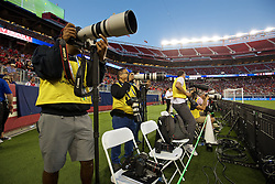 SANTA CLARA, USA - Saturday, July 30, 2016: Photographers sit behind tape a metre away from an electronic advertising board during the International Champions Cup 2016 game between AC Milan and Liverpool on day ten of the club's USA Pre-season Tour at the Levi's Stadium. (Pic by David Rawcliffe/Propaganda)