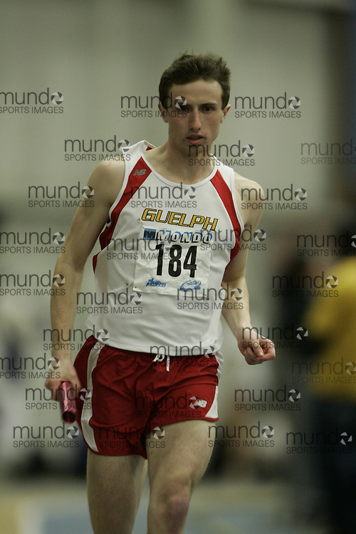 (Windsor, Ontario---13 March 2010) Evan Stevens of University of Guelph Gryphons  competes in the men's 4X400 meters at the 2010 Canadian Interuniversity Sport Track and Field Championships at the St. Denis Center. Photograph copyright GEOFF ROBINS/Mundo Sport Images. www.mundosportimages.com