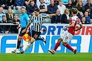 Federico Fernandez (#18) of Newcastle United crosses the ball for Ciaran Clark (#2) of Newcastle United to head in a late goal (1-2) during the Premier League match between Newcastle United and Arsenal at St. James's Park, Newcastle, England on 15 September 2018.