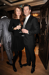 COLIN RADCLIFFE and model ANGELA DUNN at a dinner hosted by jewellers Damiani at The Connaught Hotel, London on 3rd February 2010.