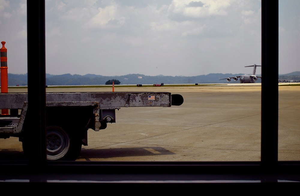 small flag on the bed of a truck in Charleston WV airport tarmac.