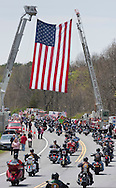 Hurley, New York  - Hundreds of motorcyles lead the motorcade escorting the body of  U.S. Army Sgt. Shawn M. Farrell II under a large American flag on Route 209 on May 7, 2014. Farrell died April 28 when forces attacked his unit with small arms fire in Afghanistan.