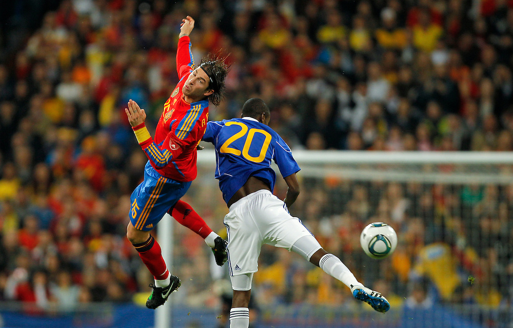 Spain's Sergio Ramos Garcia, left, vies for the ball with Colombia's Adrian Ramos, right, during an international friendly soccer match at the Santiago Bernabeu stadium in Madrid on Wednesday, Feb. 9, 2011.